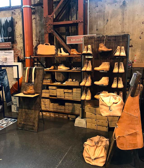 A display of boots and leather garments at New Heritage Festival Düsseldorf